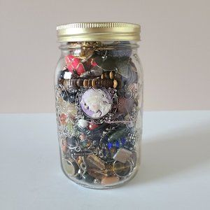 Mystery jewelry jar. All items in good  condition.